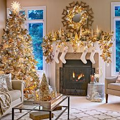 Holiday living room at night with Christmas tree and fireplace mantel decorated in a white and silver palette with copper and champagne metallic finishes.