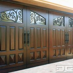 Dynamic Garage Door - Mediterranean Style Home in Laguna Niguel, CA | Dynamic Custom Wood Garage Doors - Mediterranean Garage Doors - this is a Laguna Niguel, CA complete home remodel. Dynamic Garage Door custom designed, manufactured and installed this beautiful Mediterranean Style Garage Door with gorgeous iron scrolling on the windows and hand-forged architectural handles. The raised panel design in the middle section and bottom diamond panels are made out of solid Mahogany wood. Dynamic…