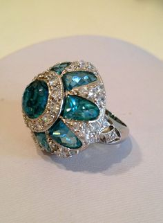 Diamond and aquamarine ring.