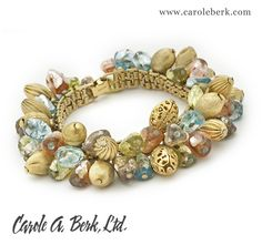 NAPIER 60's pastel charm bracelet.The charms are iridescent glass beads interspersed with  various gold toned textured melon shaped balls  SOLD