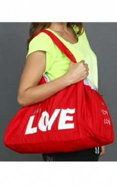 """Peace Love World :: Love2Love Bag :: Love :: Red       $62.00  This nylon number goes great over the shoulder or toted to-and-fro by its two sturdy handles. A punchy Blue exterior is printed with """"I am Love"""" across the front with signature red dashmarks, Love symbol on the opposite side, and on one end, the L2L patch and our inspirational Love quote patch on the other. Meanwhile the contrasting Grey interior boasts 4 pockets and enough room to stow the day's necessities."""