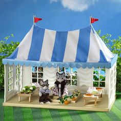 Sylvanian Families Marquee Now your Sylvanian Families can party or hold events in this fantastic blue striped Marquee. This fantastic Marquee is great for the village events and comes with a judge figure, stage and microphone http://www.comparestoreprices.co.uk/childs-toys/sylvanian-families-marquee.asp