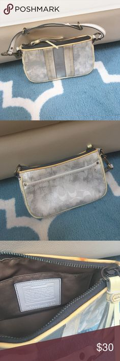 Classic Coach wristlet Silver and white Coach wristlet. Has been used as it was previously a favorite. Coach Bags Clutches & Wristlets