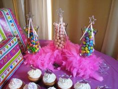 Still searching for simple princess party ideas.  Some people have a lot of time on their hands.  I like the use of the pink candy and the boa to decorate the table. http://www.fromthesamenest.com/2010/03/once-upon-time-one-year-ago-today.html