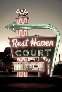 Rest Haven Court neon, Springfield, MO.  St. Louis was always the most disturbing and frightening place along this journey we kept making.  Worse than Toledo for ghetto.