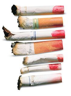 Not a smoking fan, but love the how the lipstick marks really glamorize these dirty, discarded cancer sticks.