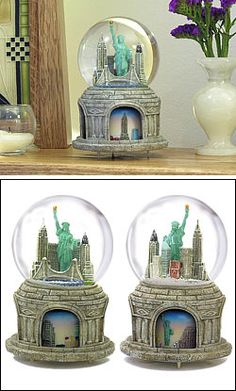 "Collector's Rotating NYC  Skyline Snow Globes  Our Collector's Snow Globe with a rotating base!  Plays ""New York, New York"".     NYCwebStore.com's most recent and exciting addition to our snow globe collection.  Features the Empire and Chrysler Buildings, the Statue of Liberty, Brooklyn Bridge and the Citicorp building.  These snow globes are true keepsakes and fun additions to any collection. The snow globe base features beautiful three-dimensional relief.     Measures 6.5""H"