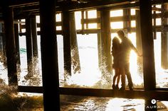 A warm hug next to the cold Pacific ocean - Santa Monica engagement session #tauranphotography