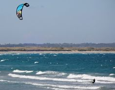 Wind surfer enjoying the waves at Port fairy east beach by fbear3
