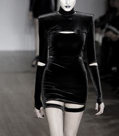 high necked velvet mini dress with sleeve gauntlets and garters.