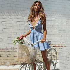 - Delicate striped blue dress, with crossed back details - Color: Blue - Material: Cotton, Polyester - Size: S, M, L, XL - Check the picture for size measurements