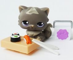 littlest pet shop cat with sushi ( and yes, those are absolutely adorable CHOPSTICKS!!!!!!)