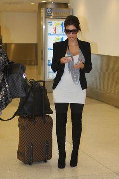 Kim Kardashian wearing Louis Vuitton Evidence Sunglasses Christian Louboutin Monica Over The Knee Boots. Kim Kardashian Arriving in Miami September 26 2010..