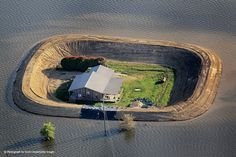 """""""Prevention""""  Yazoo River.  Surviving the flood in May 2011 - fortified by a levee"""