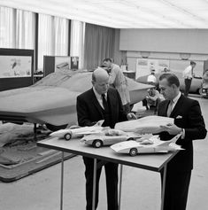 Bill Mitchell reviewing Firebirds I, II & III. Firebird IV clay model in the background.