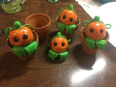 Polymer clay pumpkins in clay pot