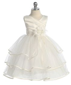 Styled to perfection this little dress is perfect for First Communion and Flower Girl Dresses. The satin bodice has a fashionable neckline and elegant pleating. The three-tiered tulle organza skirt ha