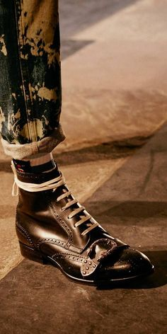 $1,550 GUCCI Queercore brogue boot - SOLD by GUCCI - affiliate - traditional brogue details with unexpected hardware and design. Inspired by the punk movement of the mid-1980s, the lace-up silhouette reflects the subculture's nonconformist spirit, completed with a studded tiger head buckle across the front-a detail that has quickly become a key embellishment for Gucci. Embroidered gold bee at the back taken Gucci's '70s archives, Tiger Head buckle, Made in Italy, leather sole
