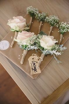 <3 rose bouts  A Rustic Wedding At Hyde Barn **** Possible Ideas for the guys... except add fall leaves instead of the white and change the rose color #weddingbouquets