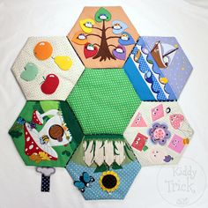 "Our busy play mat in a shape of a flower made of six soft ""petals"" and a hexagon ""core"". Each petal has different activity game for your baby to play. Excellent for development of fine motor skills, creativity, logical thinking, attention, memory etc.   Watch a video of this play mat in action: https://youtu.be/WYjzVDvghwA  Petals connected with each other by buttons and with core by snaps. Your baby can play with assembled mat on the floor or a bed or with individual petals ..."