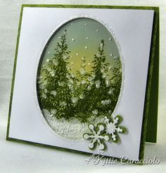 Snowy Sunset  stamped the evergreen tree from Flourishes Forest of Trees several times on glossy paper using Olive craft ink and embossed. I sponged on yellow Distress Scattered Straw for the sunset and Bordering Blue for the night sky. I added snow to the ground, trees and falling snowflakes with Liquid Applique'.