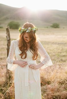 Brides: The Prettiest Wedding Hairstyles with Flower Crowns| A Bohemian Flower Crown with Daisies and Greenery | Photo by Lindsey Shaun