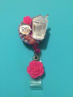 "Coffee Lovers! Silver ID holder   Hand-Blinged, Hand Crafted &  Uniquely Designed Reads ""RN"" & ""COFFEE PO PRN QSHIFT"" Colors: Pink & Sliver"