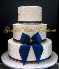 https://flic.kr/p/QPeRpc | Elegant Ivory Butter Cream Wedding Cake with Gold Sugar Pearls and Navy Blue Ribbon and Bow with Gold Bling