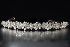 A very lovely wedding headband of alternating cultured pearl snowflakes, crystal flowers and vintage styled crystal accents.