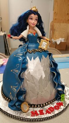 Disney Descendants Evie cake that I made. Everything is edible except the doll in the center. I got the inspiration from Koalipops.