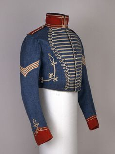 Indian NCO's short, full dress frogged jacket, 6th Bengal Light Cavalry: This jacket is worn by the military and originally a unit of Hungarian horseman. The jacket features Brandenburg piping/braiding and button closures.It played an important role in Napoleonic wars.