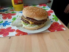 """1/2 lb 100 % pure beefburger with double cheese and lashings of fried onions and salad with the choice of 5"""" seeded or floured bap and then the sauces of your choice. ..."""