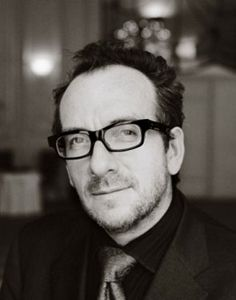 Elvis Costello. My fiance looks like a younger version of him thus to me he is beautiful =)