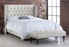 Great inexpensive Wing Bed. One Kings Lane - The Art of Upholstery - Parker Tufted Wingback Bed, Talc