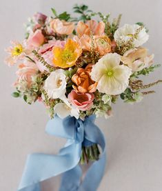 With its bright colors and happy blooms, we can't help but smile looking at this gorgeous bouquet! | Photograph