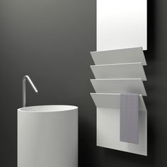 Flaps is made entirely of recyclable aluminum and is distinguished by a plate, interrupted by flaps which give the radiator its name and which are used as towel rails.