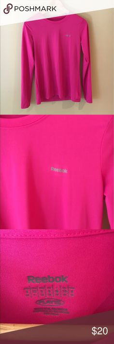 Reebok pink long sleeve workout shirt Bright pink moisture wicking shirt from reebok. No signs of wear. Great for runs and outdoors Reebok Tops Tees - Long Sleeve