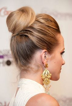 Top Knot Bun Hairstyle  might take a lot of bobby-pins but do-able.