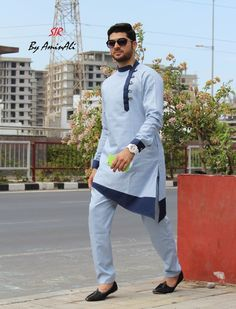Mens Designer festive cotton pathani suit with collar neck, short button placket and full sleeves and curve hem. Comes with matching bottom. Nigerian Men Fashion, Indian Men Fashion, Mens Fashion Suits, Wedding Kurta For Men, Wedding Dresses Men Indian, Gents Kurta Design, Boys Kurta Design, Mens Indian Wear, Mens Ethnic Wear