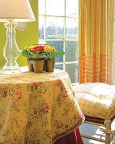 The rose pattern of the  tablecloth pairs pleasantly with yellow or green walls for a room with a garden feel that doesn't rely too heavily on pinks and reds - Decorative Roses - Southern Lady Magazine