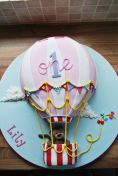 1st birthday hot air balloon cake with monkey made by http://www.flickr.com/photos/the-icing-on-the-cake/