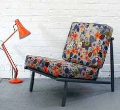 LOVE this print and the chair. And the light. Er, the brick wall too....  Brie Harrison via Design*Sponge