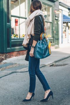Jess Ann Kirby in cozy fall outfit wearing skinny jeans, pumps and blanket scarf