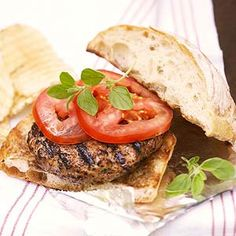 Grilled Herb Burgers: Oregano and basil pack these grilled burgers with great flavor.