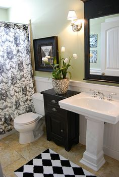 need to do a black and white bathroom to tie the guest bedroom (black, white and red) and nursery (black, white and blue) together.