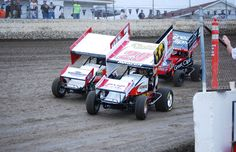 Side-by-side racing between Kerry Madsen (#29) and Jason Sides (#7s), with Joey Saldana (#9) closing in - Doug Vendeventer Photo