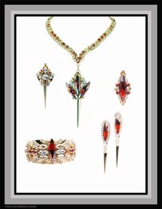Avant Garde Spike Statement Parure features necklace lanyard with 2-sided (reversable) pendant, cuff bracelet, earrings and brooch.  All Swarovski crystal in both vintage and current market stones - gold plated - by Bryan Greenwood of Crystal Countess / Jewellery by Greenwood Design