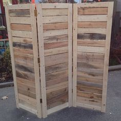 This pallet wall from etsy looks great, and if you're living in a studio or a loft, it's a great way to breakup the apartment without blocking natural light.
