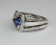Our diamond rings embrace Romance, Beauty & sparkling Diamond Brilliance. Each diamond ring is delicately created by skilled craftsmanship. Tanzanite Engagement Ring, Designer Engagement Rings, Ring Designs, Diamond Jewelry, Sapphire, Pure Products, Gemstones, Diamond Jewellery