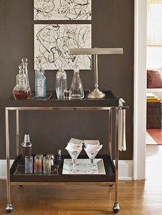 Small-Space Bungalow on a Budget Nod to Nostalgia: The liquor cart is a throwback to the cocktail hour aesthetic of the 1940s and 1950s. When guests are over, it doubles as a buffet or as a popcorn and snack station for slumber parties. Make the artwork by splattering leftover paint on purchased canvases.